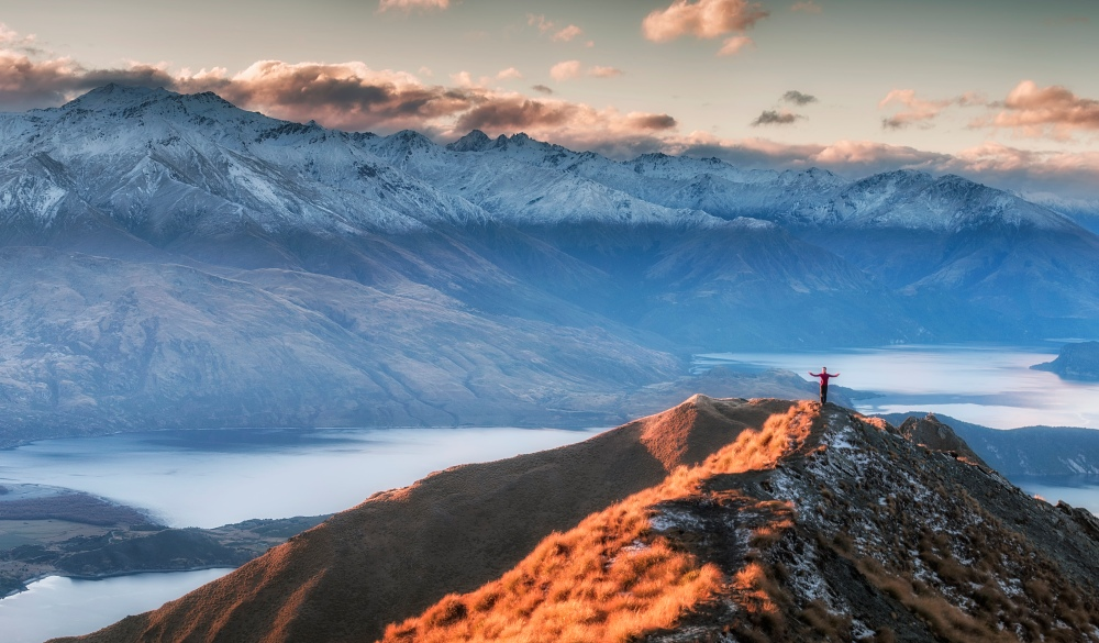 Man Standing On the Top of Mount Roy, south island road trip destination