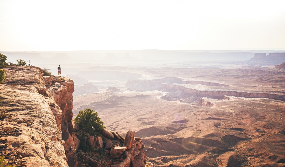 One Person Overlooking Canyonlands National Park in Utah During Sunset