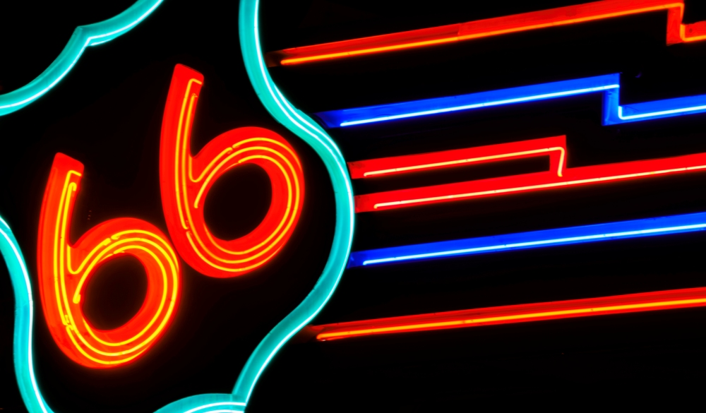 public street neon route 66 sign at night in Albuquerque