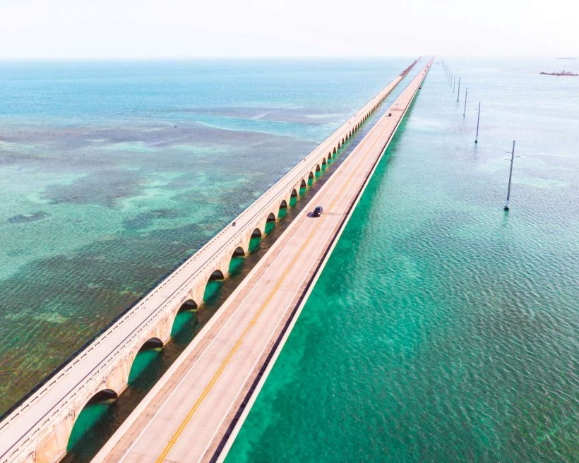 Drone view of the Overseas Highway in Florida Keys with turquoise color and infinite road.