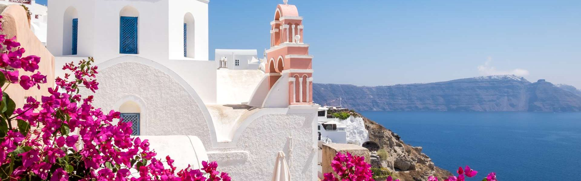 traditional cycladic houses with flowers in foreg