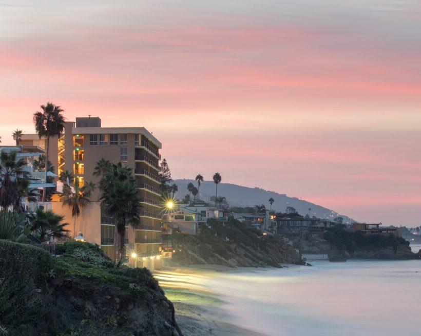 Landscape view of cliffs and beach at dawn, Laguna Beach, California, USA