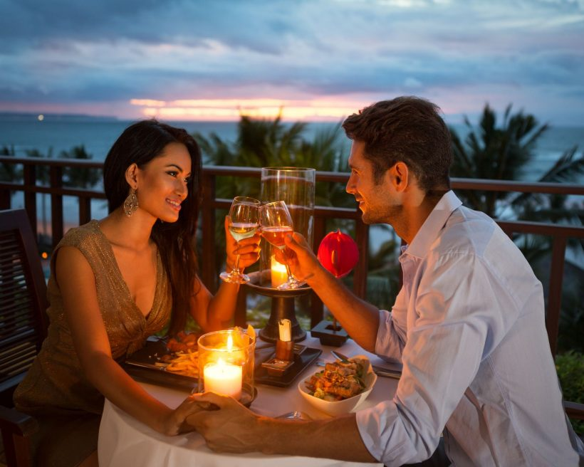 young couple enjoying a romantic dinner by candlelight,