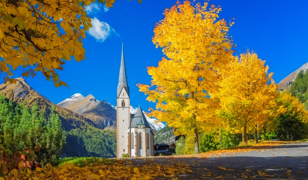 Heiligenblut Alpine village with beautiful pilgrimage church in autumn, destination for road trips in austria