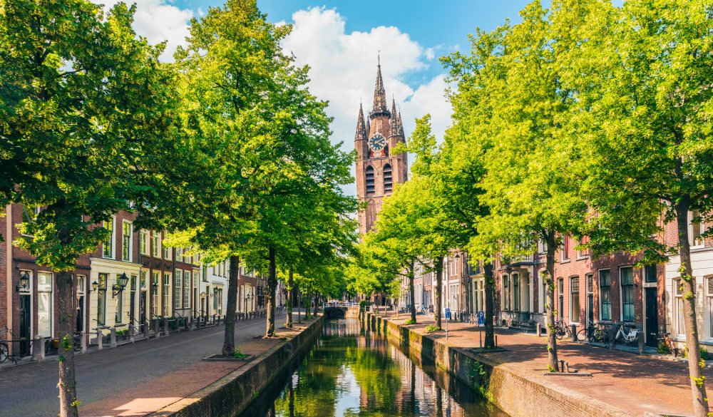 Canal with Leaning Church Tower in Delft Netherlands
