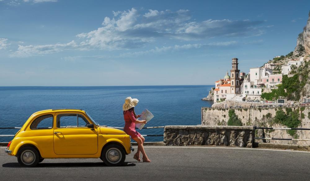 Woman holding map, Italian road trip