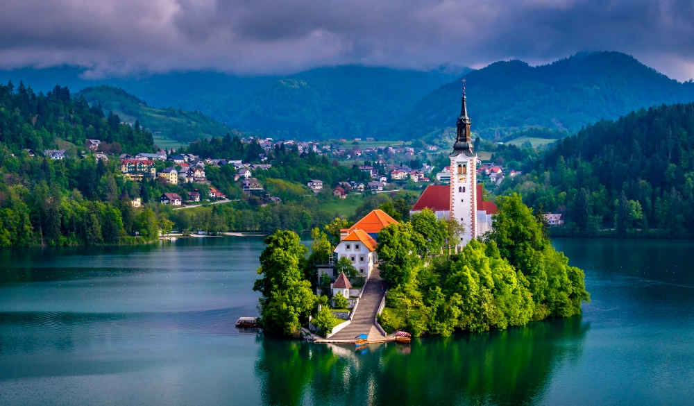 Beautiful view of Pilgrimage Church of the Assumption of Maria, famous Bled Island (Blejski otok), and scenic Bled Lake, with Julian Alps in the background, Slovenia, Europe.