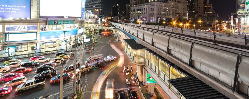 The famous Asok intersection along Sukhumvit road, the main road in downtown Bangkok, Thailand capital city at night