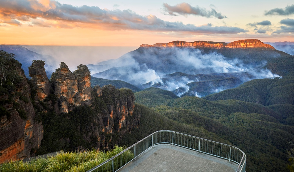 Three Sisters and Queen Elizabeth Lookout with no people and bushfire in the Jamison Valley, Blue Mountains National Park, romantic destinations in Australia