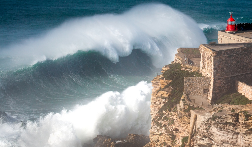 giant wave crashing into cliff, destination for portugal road trip