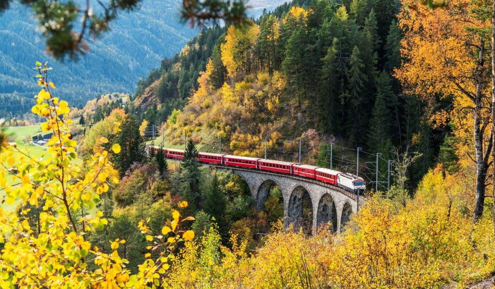 Bernina Express train in autumn, Filisur, Switzerland, scenic train ride