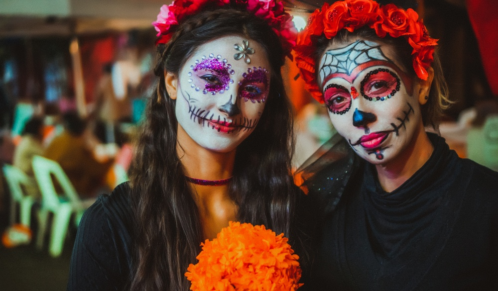 Portrait of a mother and daughter with traditional make up for the day of the dead celebration