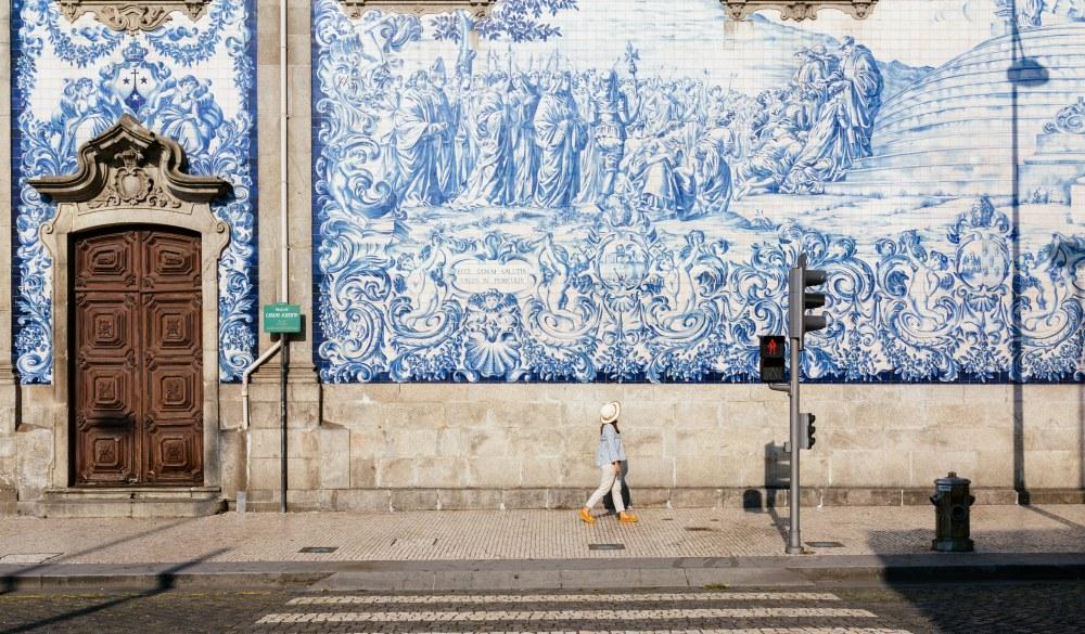 girl walking through the streets in Porto
