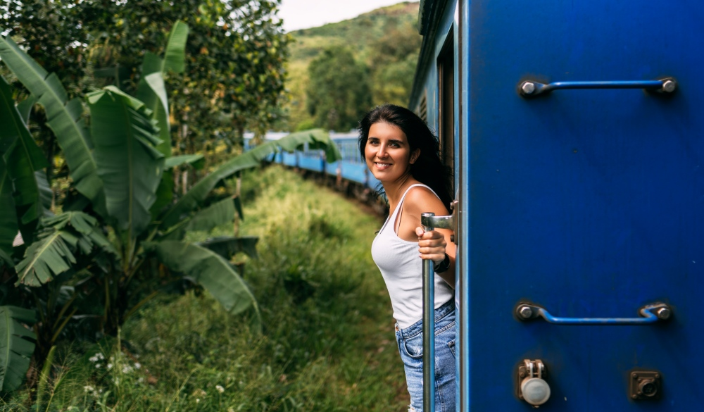 Beautiful Girl Traveling By Train Among Mountains
