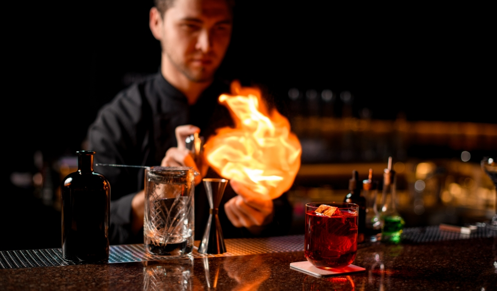 bartender serving the red alcoholic cocktail