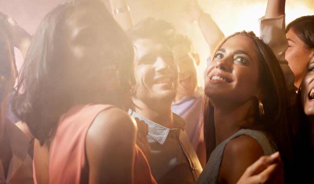 Friends dancing at nightclub in Barcelona