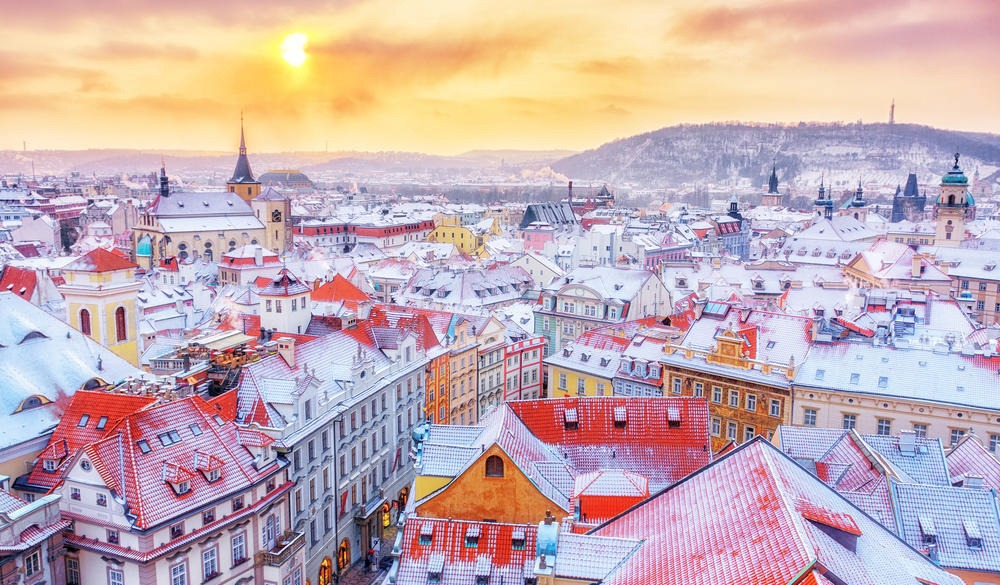 Prague, classical view of snowy roofs, city center. Winter scene.