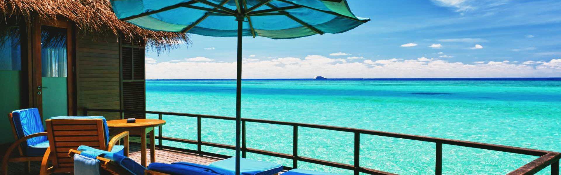Overwater villa balcony overlooking tropical lagoon