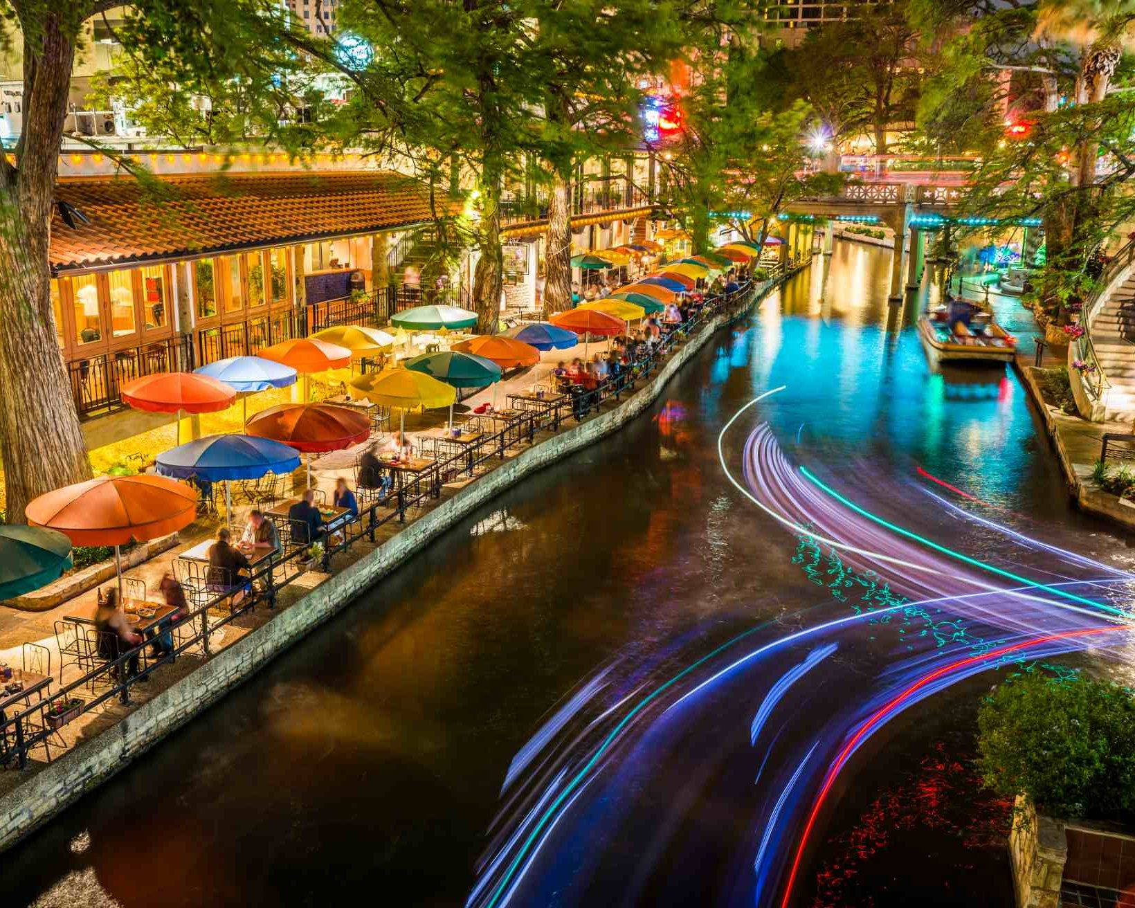 San Antonio Riverwalk, Texas, scenic river canal tourism umbrellas night