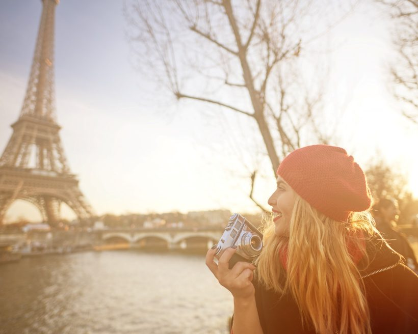 tourist woman in Paris holding camera