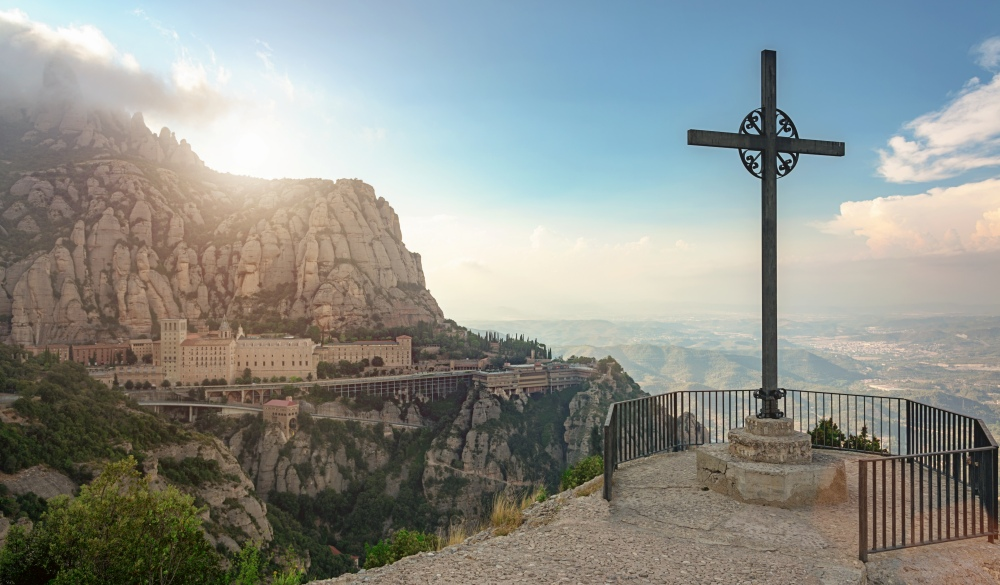 Christian cross from Montserrat Mountain viewpoint at sunset