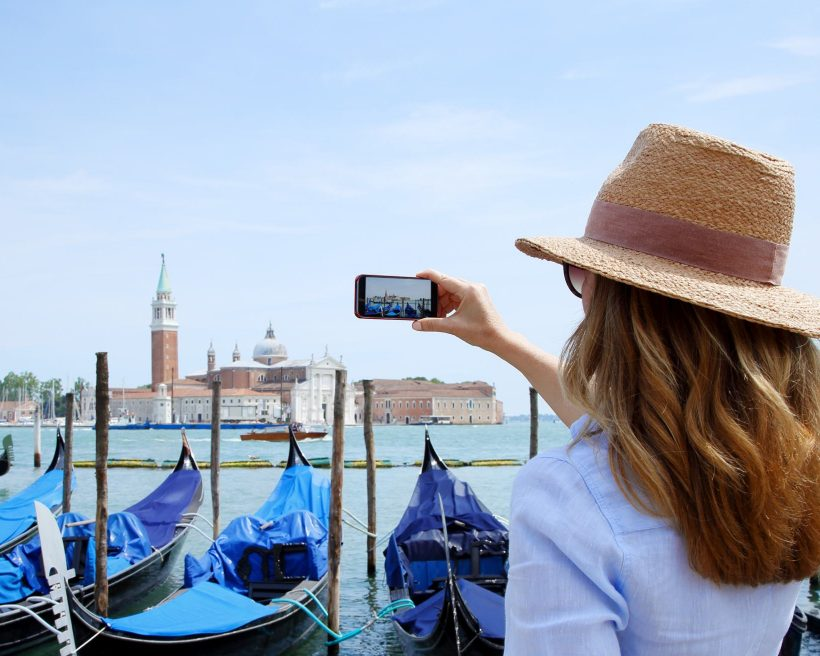 female tourist with mobile phone